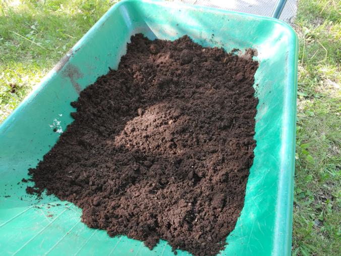 peat in a wheelbarrow
